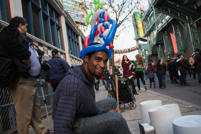 Boston, Oct. 30, 2013 -- Jermaine Carter, center left, uses upside down plastic bins and pans as drums near Fenway Park in Boston, MA. The Boston Red Sox played against the St. Louis Cardinals at Fenway Park in the 6th game of the World Series. Photograph by Carolyn Bick.