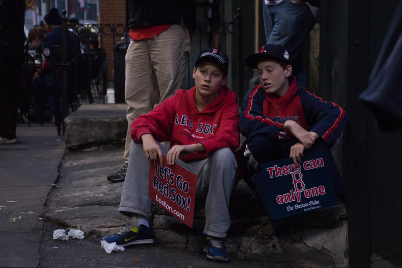 Boston, Oct. 30, 2013 -- Sean Thompson, right, and Kyle Greenler, left, talk outside Fenway Park in Boston, MA. The Boston Red Sox played against the St. Louis Cardinals at Fenway Park in the 6th game of the World Series. Photograph by Carolyn Bick.