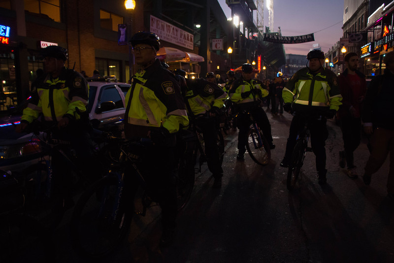 Boston, Oct. 30, 2013 -- Police ride down Lansdowne Street outside Fenway Park in Boston, MA. The Boston Red Sox played against the St. Louis Cardinals at Fenway Park in the 6th game of the World Series. Photograph by Carolyn Bick.