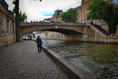 Lone man along Seine
