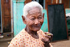 Bagan -  Woman smoking Cheroot (Burmese traditional cigars)