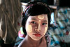 Sittwe -  girl with thanaka makeup paste made from thanaka tree ground bark and used all over Burma for protection from the sun