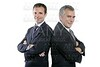 two adult businessman posing team together