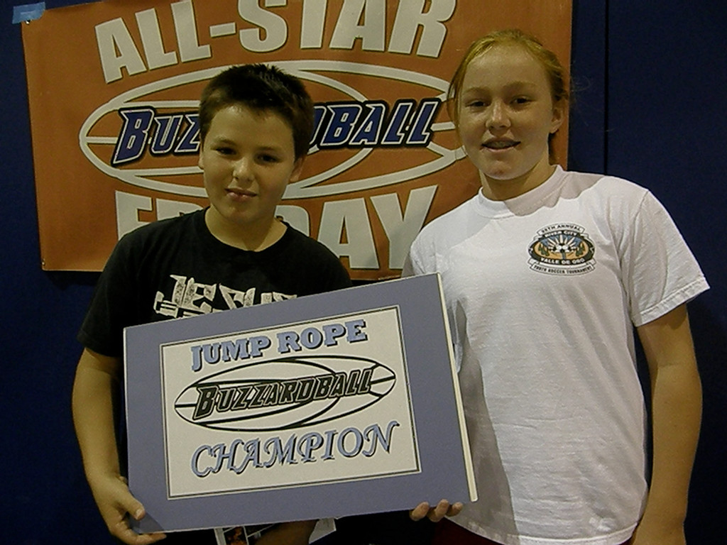 FR-SOPH CHAMPS: ROCKETS' TOPH BUZZARD (173) and ALEXA GRIGGS (111) -- 284 JUMPS