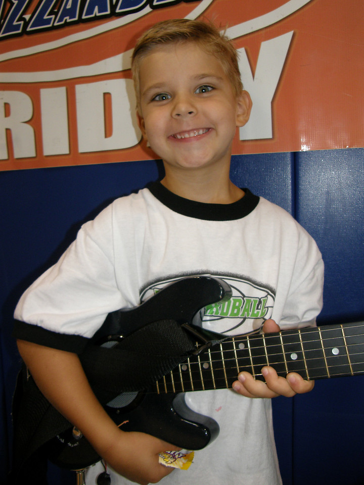 TALENT SHOW CO-CHAMP: COLLIN (SPURS) -- playing the electric guitar