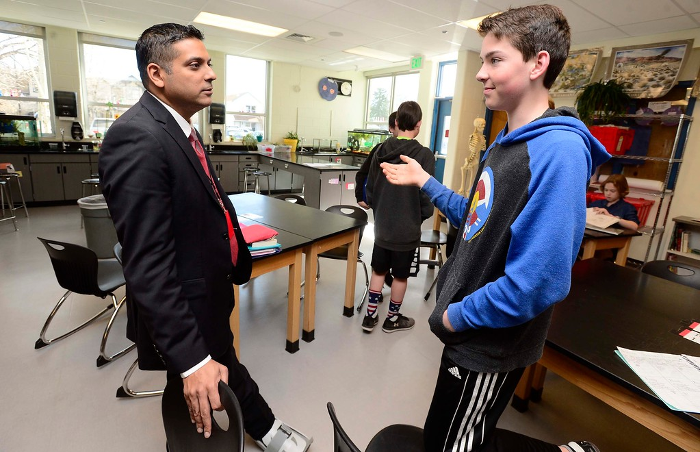 . Krish Mohip, one of the finalists for the Boulder Valley School District\'s superintendent position, chats with student Sean Kendall at Louisville Middle School on Friday. Mohip, is currently Youngstown City Schools Chief Executive Officer.  For more photos go to dailycamera.com Paul Aiken Staff Photographer March 9 2018