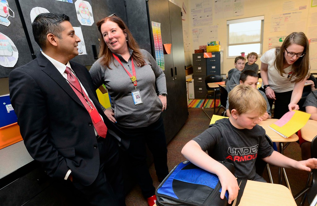 . Krish Mohip, one of the finalists for the Boulder Valley School District\'s superintendent position, chats with school principal Ginny Vidulich as they visit Bethany Konz\' math class at Louisville Middle School on Friday. Mohip, is currently Youngstown City Schools Chief Executive Officer.  For more photos go to dailycamera.com Paul Aiken Staff Photographer March 9 2018