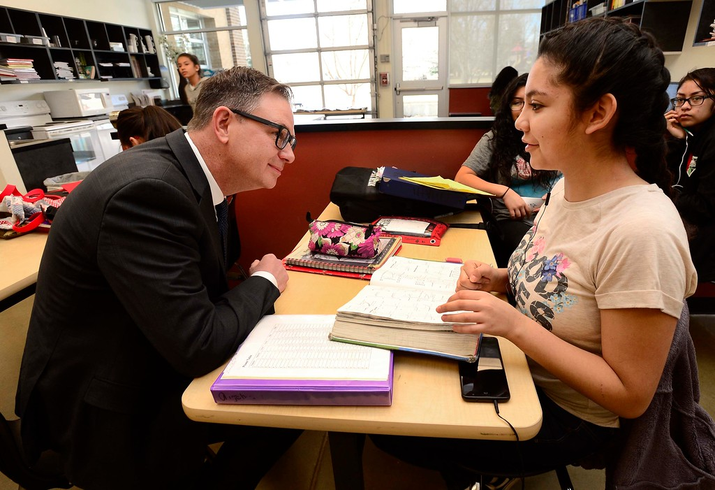 . Rob Anderson, one of the finalists for the Boulder Valley School District\'s superintendent position, stops to talk to 8th grader Andrea Sanchez about her studies in her classroom at Louisville Middle School on Friday. Anderson, is currently a deputy superintendent in Atlanta\'s Fulton County Schools. For more photos go to dailycamera.com Paul Aiken Staff Photographer March 9 2018