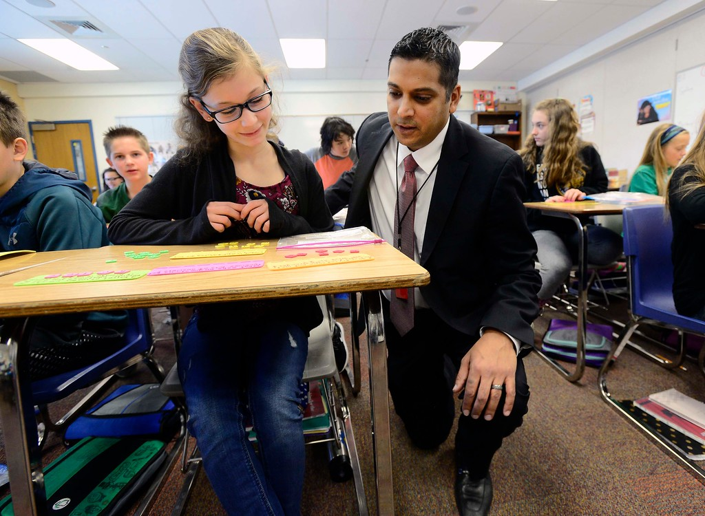 . Krish Mohip, one of the finalists for the Boulder Valley School District\'s superintendent position, talks with student Faith Horn at Louisville Middle School on Friday. Mohip, is currently Youngstown City Schools Chief Executive Officer.  For more photos go to dailycamera.com Paul Aiken Staff Photographer March 9 2018