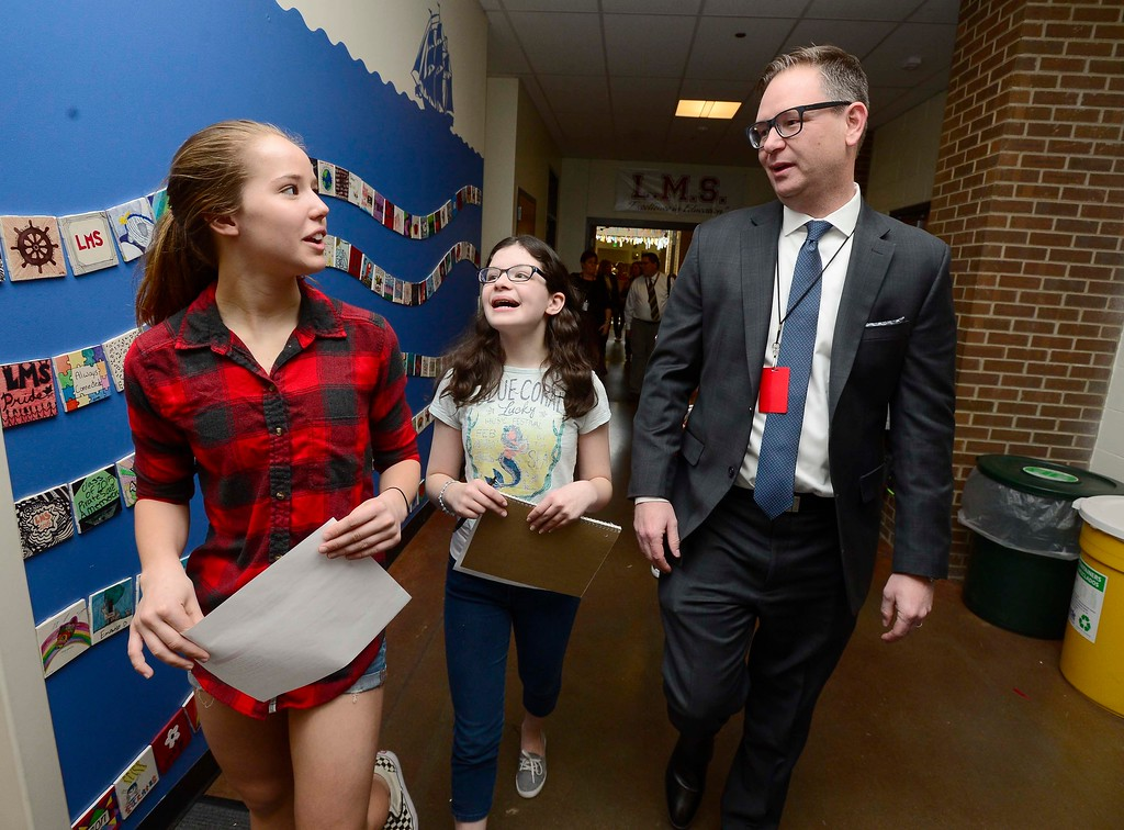 . Rob Anderson, one of the finalists for the Boulder Valley School District\'s superintendent position, chats with his tour guides Keira Bond, left and Cyan Shaw at Louisville Middle School on Friday. Anderson, is currently a deputy superintendent in Atlanta\'s Fulton County Schools. For more photos go to dailycamera.com Paul Aiken Staff Photographer March 9 2018