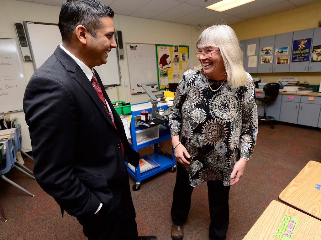. Krish Mohip, one of the finalists for the Boulder Valley School District\'s superintendent position, talks with teach Shelagh Turner at Louisville Middle School on Friday. Mohip, is currently Youngstown City Schools Chief Executive Officer.  For more photos go to dailycamera.com Paul Aiken Staff Photographer March 9 2018