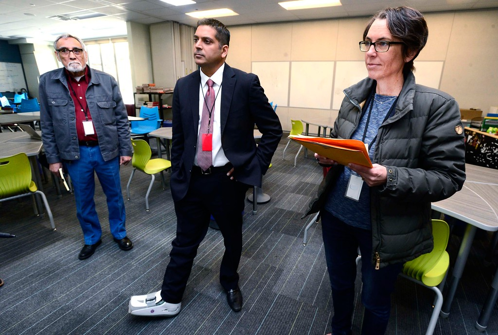 . Krish Mohip, one of the finalists for the Boulder Valley School District\'s superintendent position, tours Louisville Middle School with board members Richard Garcia and Tina Marquis on Friday. Mohip, is currently Youngstown City Schools Chief Executive Officer.  For more photos go to dailycamera.com Paul Aiken Staff Photographer March 9 2018