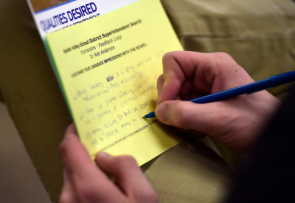 . Broomfield High School junior Sam Hahn writes down questions for Rob Anderson, a finalist for the Boulder Valley School District Superintendent position, as he speaks during an interview on Thursday at the Boulder Valley Eduction Center in Boulder.  For more photos of the interviews go to dailycamera.com Jeremy Papasso/ Staff Photographer 03/08/2018