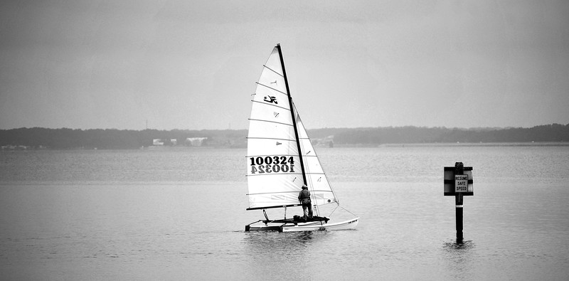 A catamaran heads out onto the Ross Barnett Reservoir from the Old Trace Park boat launch in Ridgeland on an overcast Sunday afternoon.
