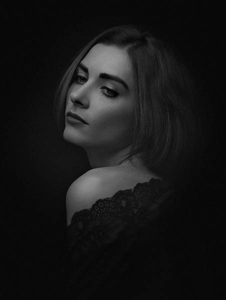 Dramatic female portrait against dark backgrounds