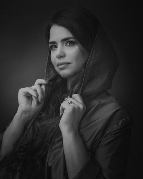Beautiful plus size model posing at camera, dramatic female portrait
