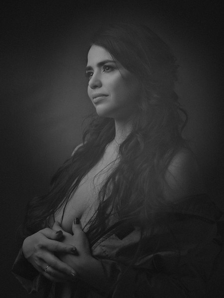 Beautiful plus size model posing at camera, dramatic female portrait