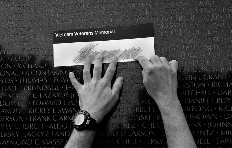 Reaching for a friend. On the Vietnam Memorial.