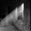 <b><center><em> Sunlight in an old adobe house<br> The lady of the house is walking down the steps with her youngest, this is a home where two families and a tribe of goats live.