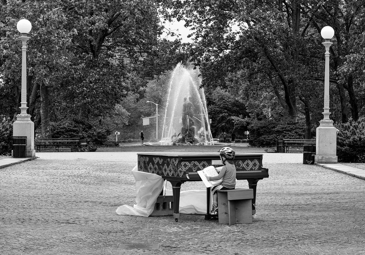 Playing a piano at the Grand Army Plaza Brooklyn NY