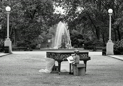 Playing a piano at the Grand Army Plaza Brooklyn NY
