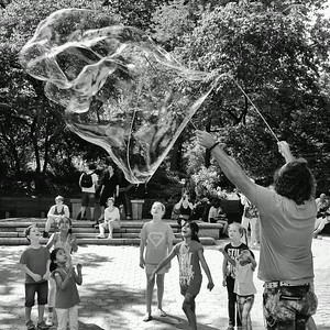 Blowing bubbles in Central Park NYC