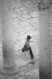 In Jerusalem, a Hassidic child runs among the ruins in the Jewish Quarter of the Old City.