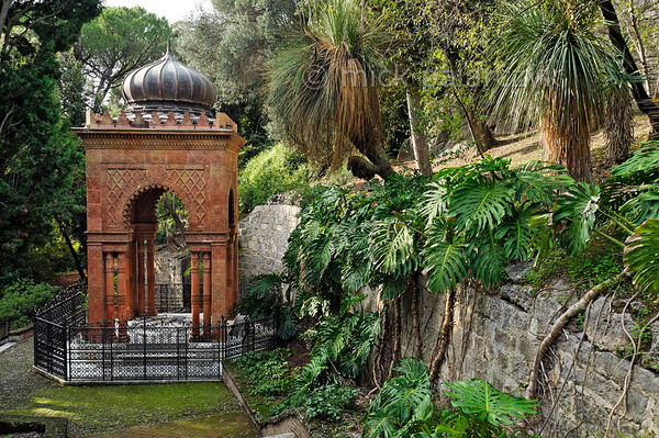 [ITALY.LIGURIA 28982] 'Moorish Kiosk in Hanbury Gardens.'  The Moorish Kiosk in the Hanbury Botanical Gardens is an orientalized mausoleum built in 1886 by the architect Pio Soli. It holds the ashes of Thomas Hanbury, founder of the Hanbury Gardens on the Côte d'Azur near Ventimiglia. The steps leading to the kiosk are flanked by the leaves of Monstera deliciosa. Photo Mick Palarczyk.