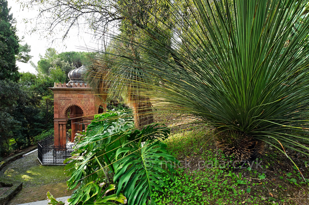 [ITALY.LIGURIA 28983] 'Moorish Kiosk in Hanbury Gardens.'  The Moorish Kiosk in the Hanbury Botanical Gardens is an orientalized mausoleum built in 1886 by the architect Pio Soli. It holds the ashes of Thomas Hanbury, founder of the Hanbury Gardens on the Côte d'Azur near Ventimiglia. In the foreground a Dasylirion. Photo Mick Palarczyk.