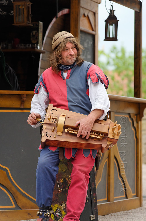Hurdy-gurdy player at historical market in Thuringia