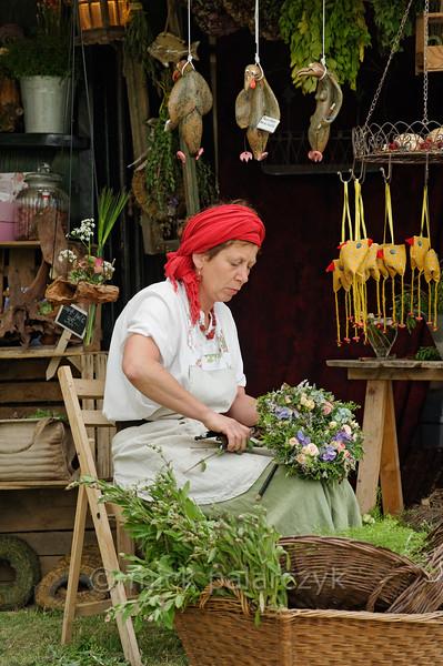 Flower seller at historical market in Thuringia.