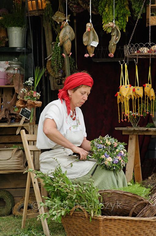 Flower seller at historical market in Thuringia.