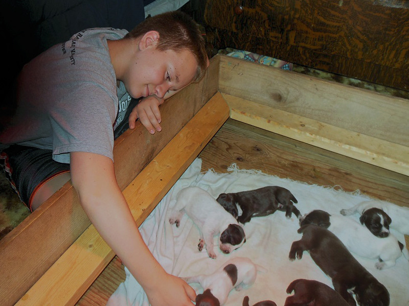 Nathan with 2-week old pups