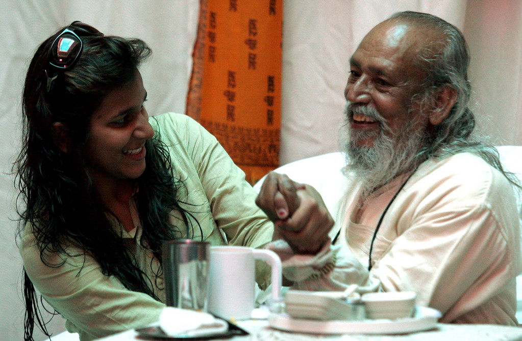 . Baba Hari Dass enjoys a playful arm wrestle in 2007, with Prabha Sharan, one of the orphans adopted at Sri Ram Ashram in India. Sharan came to  the Mount Madonna Community as a girl, graduated from Mount Madonna School and is currently a nurse at Stanford Hospital. (Shmuel Thaler -- Santa Cruz Sentinel)