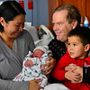 KRISTOPHER RADDER — BRATTLEBORO REFORMER<br /> Lifei Osborne looks at her newborn child, Jonah Xiao Yi Zhu Osborne, as her husband, Ladd, and 4-year-old son, Zhongyi Osborne, look on at her at the Brattleboro Memorial Hospital's Birthing Center on Wednesday, Jan. 1, 2020.