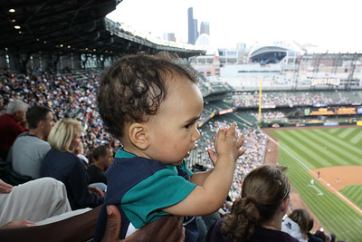 Esther practices her clapping. Go Mariners!