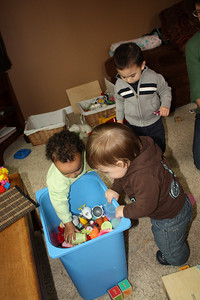 Esther, Canyon and Quinn check out the toy box