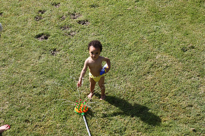 Playing in the sprinkler at Bibi's