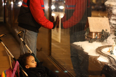 Baba makes the train move at the Macy's Christmas window.