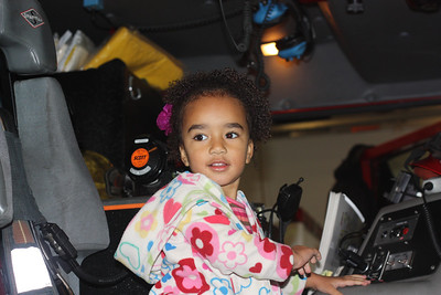 Esther in a fire truck during our tour of the Mill Creek fire dept