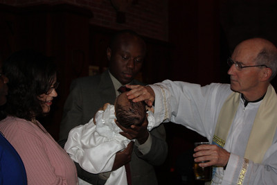 Esther gets oil on her head after the baptism