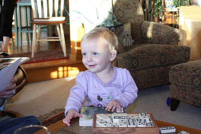 Greta playing with dominos