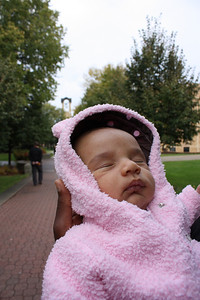Tired baby with the belltower