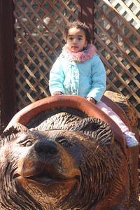 Riding the bear at the Big Bear rescued animals zoo