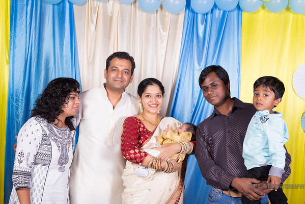 Candid photography for naming ceremony. Contact us for pricing and packages.