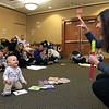 Sheryl White with Baby Kneads signs the word for bubble popping for Elliot Jean, 1, and other baby's at the sign language for babies at the Leominster Public Library on Tuesday morning. SENTINEL & ENTERPRISE/JOHN LOVE