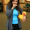 Sheryl White with Baby Kneads signs the word for duck as she makes the quack sound the the baby's during the sign language for babies at the Leominster Public Library on Tuesday morning. SENTINEL & ENTERPRISE/JOHN LOVE