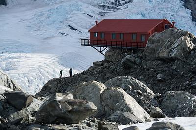 Photographers stand below Plateau Hut, Grand Plateau, Aoraki Mount Cook National Park