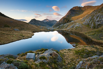 Adelaide Tarn and hut with tramper,  Kahurangi National Park