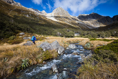 Tramper approaching Upper Travers Hut, Nelson Lakes National Park